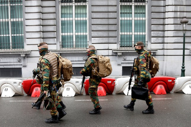 Belgian soldiers take positions outside a meeting of the government's security council in Brussels, Belgium, June 18, 2016. REUTERS/Francois Lenoir