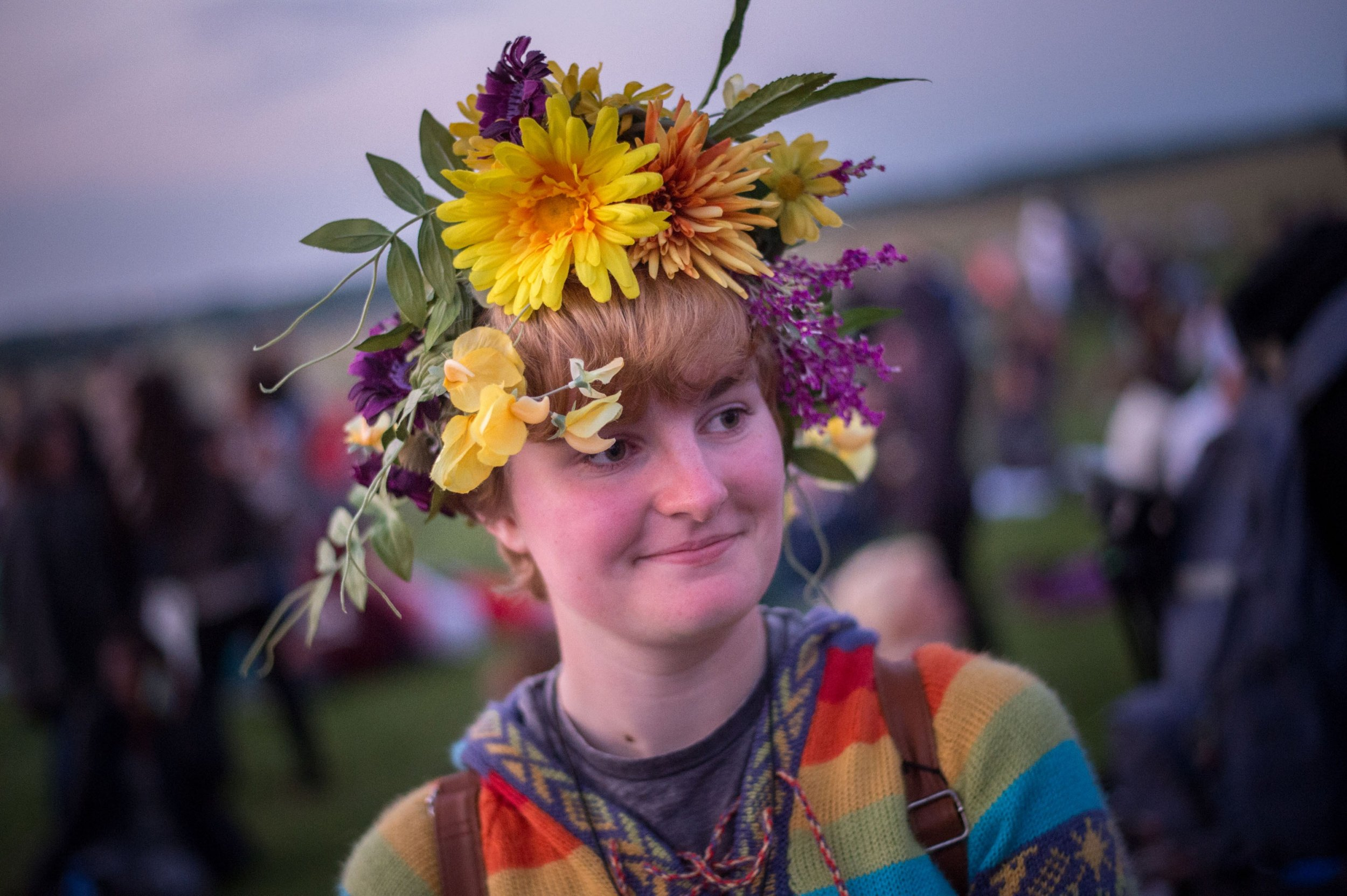 WILTSHIRE, ENGLAND - JUNE 20: People prepare for the summer solstice dawn celebrations as druids, pagans and revellers gathered the night before the Summer Solstice sunrise at Stonehenge on June 20, 2014 in Wiltshire, England. A sunny forecast brought thousands of revellers to the 5,000 year old stone circle in Wiltshire to see the sunrise on the Summer Solstice dawn. The solstice sunrise marks the longest day of the year in the Northern Hemisphere. (Photo by Tim Ireland/Getty Images)