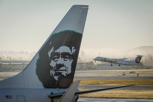 Alaska Airlines Horizon Air Bombardier Q400 plane takes-off at the Portland, Oregon International Airport, December 30, 2015. (Photo by John Gress/Corbis via Getty Images)