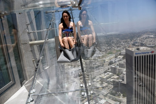 A member of the media rides the Skyslide from the 70th to 69th floor of the U.S. Bank Tower which is attached to the OUE Skyspace LA observation deck in downtown Los Angeles, California, U.S., June 23, 2016. REUTERS/Bob Riha, Jr.