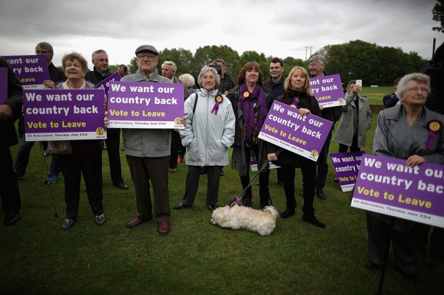 SHEFFIELD, ENGLAND - MAY 25: Vote Leave supporters listen to UKIP leader Nigel Farage as he campaigns for votes to leave the European Union on May 25, 2016 near Sheffield, England. Nigel Farage took his battle bus to Chapeltown, near Sheffield, encouraging British people to vote to leave the EU in the June 23rd referendum. (Photo by Christopher Furlong/Getty Images)