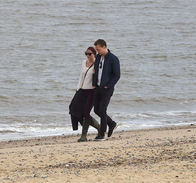 Taylor Swift and new boyfriend Tom Hiddleston enjoy a romantic walk on the beach near Lowestoft in Suffolk. They were joined by Tom's mother and some other friends. After around 2 hours they returned to their cars, and were given a Police escort back towards their house Featuring: Taylor Swift, Tom Hiddleston Where: London, United Kingdom When: 26 Jun 2016 Credit: Will Alexander/WENN.com