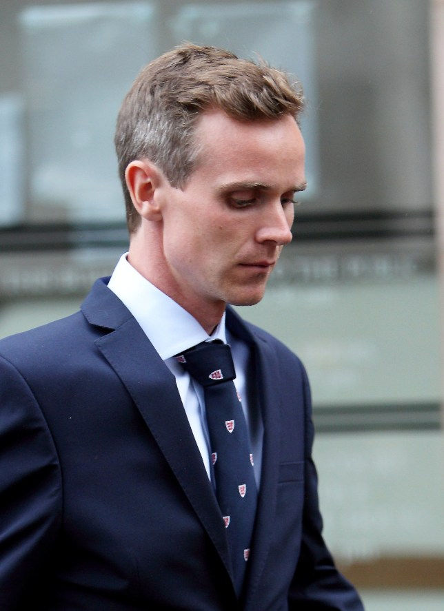 """Jesse Burgoine appearing at Nottingham Crown Court. Two members of a university rowing team filmed themselves raping a woman after she passed out drunk before sharing """"trophy pictures"""" of her on WHATSAPP, a court heard. See NTI story NTIRAPE. Jesse Burgoine, 28, and Artjom Nepryahin, 25, are accused of sending images of the victim's naked bottom to a WhatsApp group called 'The Gruesome Threesome'. Nottingham Crown Court heard the pair targeted the young woman in a nightclub before taking her home and raping her on a sofa after she fell asleep. A graphic 24-second video played to the jury on Monday (27/6) appeared to show Burgoine having sex with the victim. Nepryahin is accused of taking the woman's pulse and filming what was happening as the woman lay passed out on a sofa."""