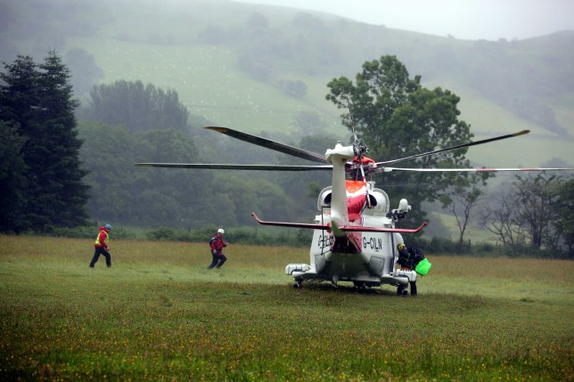 Pictured: A Coastguard helicopter lands in a field at Tafarn y Gerreg in Powys, Wales UK. Wednesday 29 June 2016 Re: Rescuers have found a number of the 24 children who went missing the Brecon Beacons. Dyfed-Powys Police said a Coastguard helicopter had found some the children, who are from St Albans, Hertfordshire. The helicopter has landed and the crew are with the children, but their condition is not known. The alarm was raised at about 13:00 BST after the groups went missing around Llyn y Fan Fach, near Abercraf. The children are in their mid teens and were on the beacons as part of their Duke of Edinburgh Award. Mark Moran from Central Beacons Mountain Rescue said his team had been in intermittent phone contact with the four groups of six children before the first group were found. Credit: Dimitris Legakis/Athena Pictures