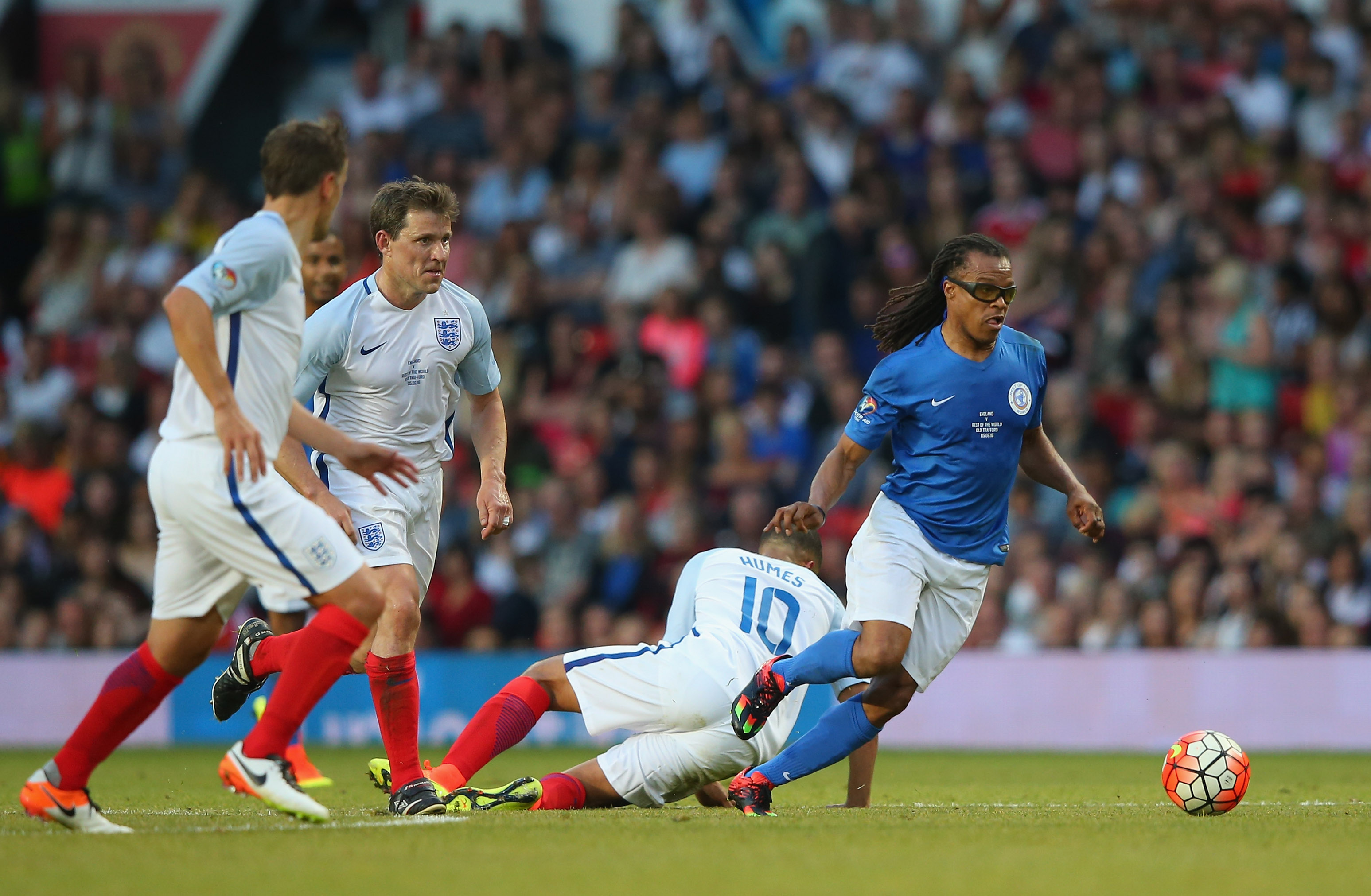 MANCHESTER, ENGLAND - JUNE 05:  Edgar Davids of Rest of the World beats Marvin Humes of England during the Soccer Aid 2016 match in aid of UNICEF at Old Trafford on June 5, 2016 in Manchester, England.  (Photo by Alex Livesey/Getty Images)