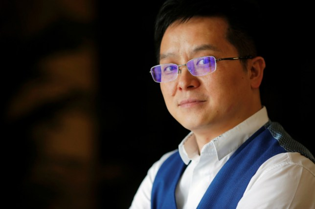 Xia Jiantong, the chairman of Recon Group, who has agreed to buy English soccer club Aston Villa, poses for pictures in his office in Beijing, China May 19, 2016. REUTERS/Damir Sagolj TPX IMAGES OF THE DAY - RTSEZ3D