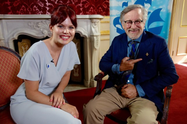 Programme Name: Blue Peter - TX: n/a - Episode: n/a (No. n/a) - Picture Shows: Lindsey Russell presents Steven Speilberg with a Gold Blue Peter badge. Lindsey Russell, Steven Speilberg - (C) BBC - Photographer: n/a