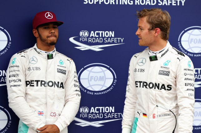 MONTREAL, QC - JUNE 11: Lewis Hamilton of Great Britain and Mercedes GP and Nico Rosberg of Germany and Mercedes GP talk in parc ferme during qualifying for the Canadian Formula One Grand Prix at Circuit Gilles Villeneuve on June 11, 2016 in Montreal, Canada. (Photo by Mark Thompson/Getty Images)