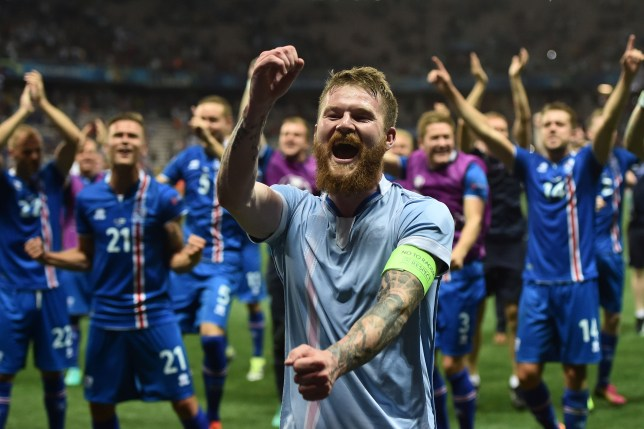 TOPSHOT - Iceland's midfielder Aron Gunnarsson and team mates celebrate after the Euro 2016 round of 16 football match between England and Iceland at the Allianz Riviera stadium in Nice on June 27, 2016. Iceland won the match 1-2. / AFP / BERTRAND LANGLOIS (Photo credit should read BERTRAND LANGLOIS/AFP/Getty Images)