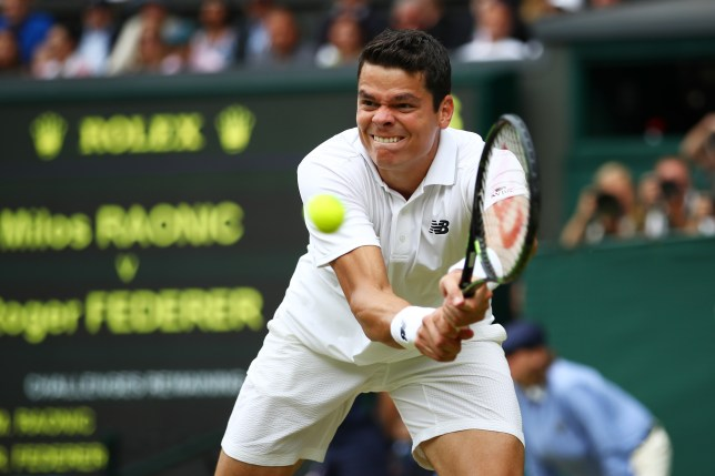 LONDON, ENGLAND - JULY 08: Milos Raonic of Canada plays a backhand during the Men's Singles Semi Final match against Roger Federer of Switzerland on day eleven of the Wimbledon Lawn Tennis Championships at the All England Lawn Tennis and Croquet Club on July 8, 2016 in London, England. (Photo by Clive Brunskill/Getty Images)