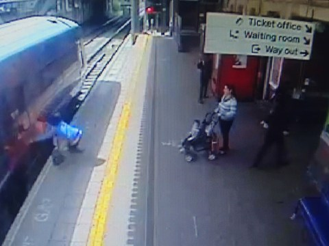 Woman dragged 60ft by train when hand got caught