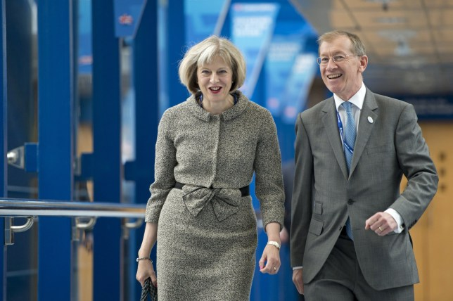 Home Secretary Theresa May and her husband Philip, arrive to listen to Prime Minster David Cameron's keynote address on the final day of the annual Conservative Party Conference in Birmingham, central England, on October 1, 2014. Talk of treason cast a shadow over Britain's Conservative party conference this week, where gossip raged over who might be next to defect to the anti-EU UK Independence Party (UKIP). AFP PHOTO / OLI SCARFF (Photo credit should read OLI SCARFF/AFP/Getty Images)