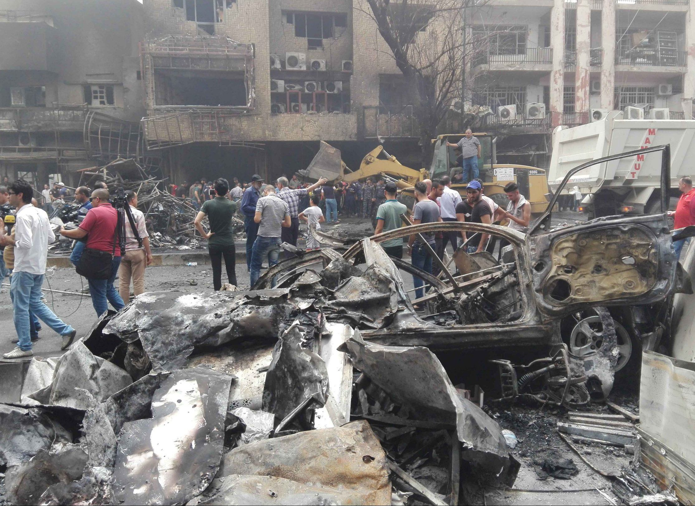 Mandatory Credit: Photo by Xinhua/REX/Shutterstock (5744685a) Scene of the attack Car bomb attack, Baghdad, Iraq - 03 Jul 2016 At least 125 people have been killed and about 150 injured in an explosion claimed by the Islamic State group in Baghdad