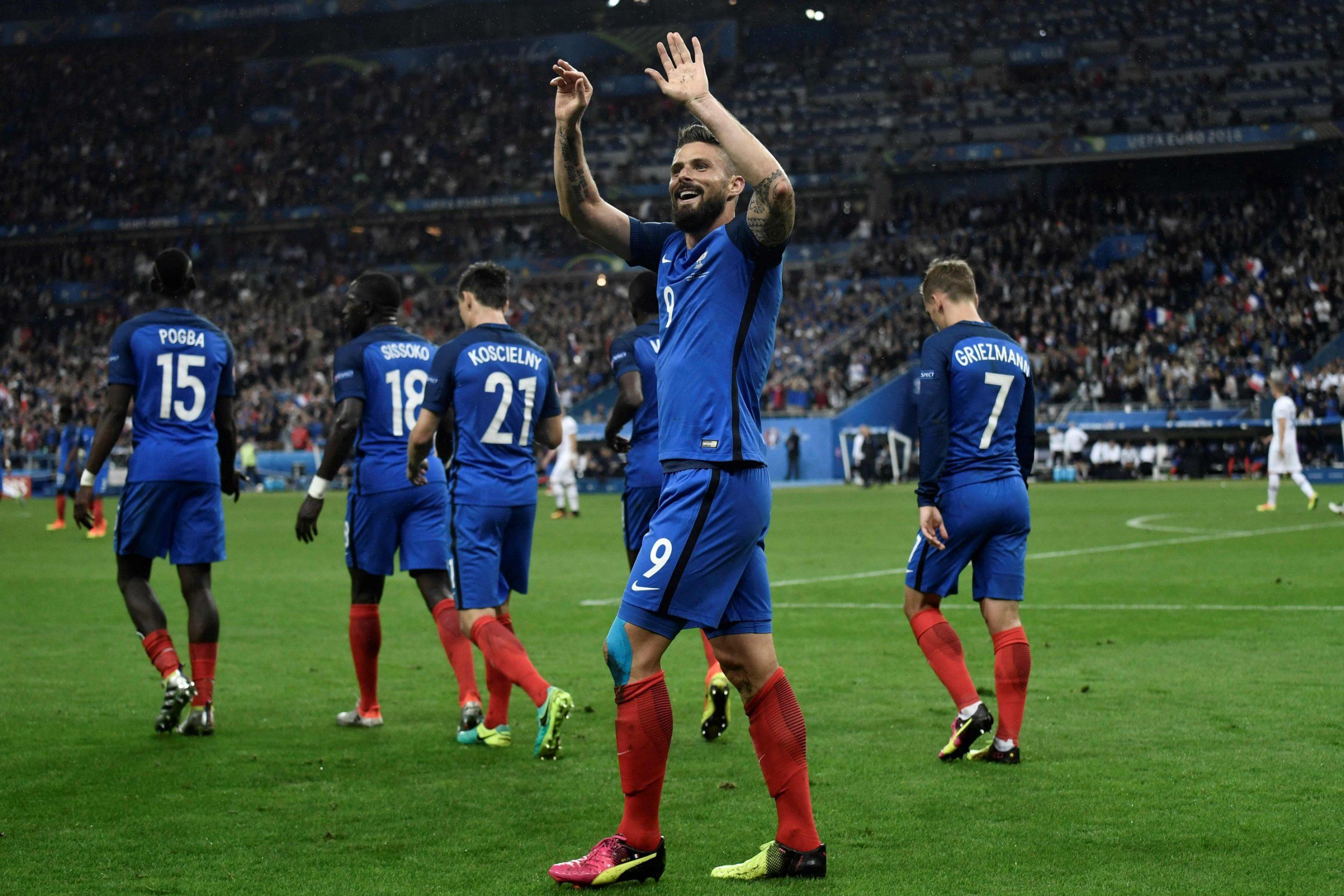 France's forward Olivier Giroud celebrates after scoring another goal during the Euro 2016 quarter-final football match between France and Iceland at the Stade de France in Saint-Denis, near Paris, on July 3, 2016. / AFP PHOTO / PHILIPPE LOPEZPHILIPPE LOPEZ/AFP/Getty Images
