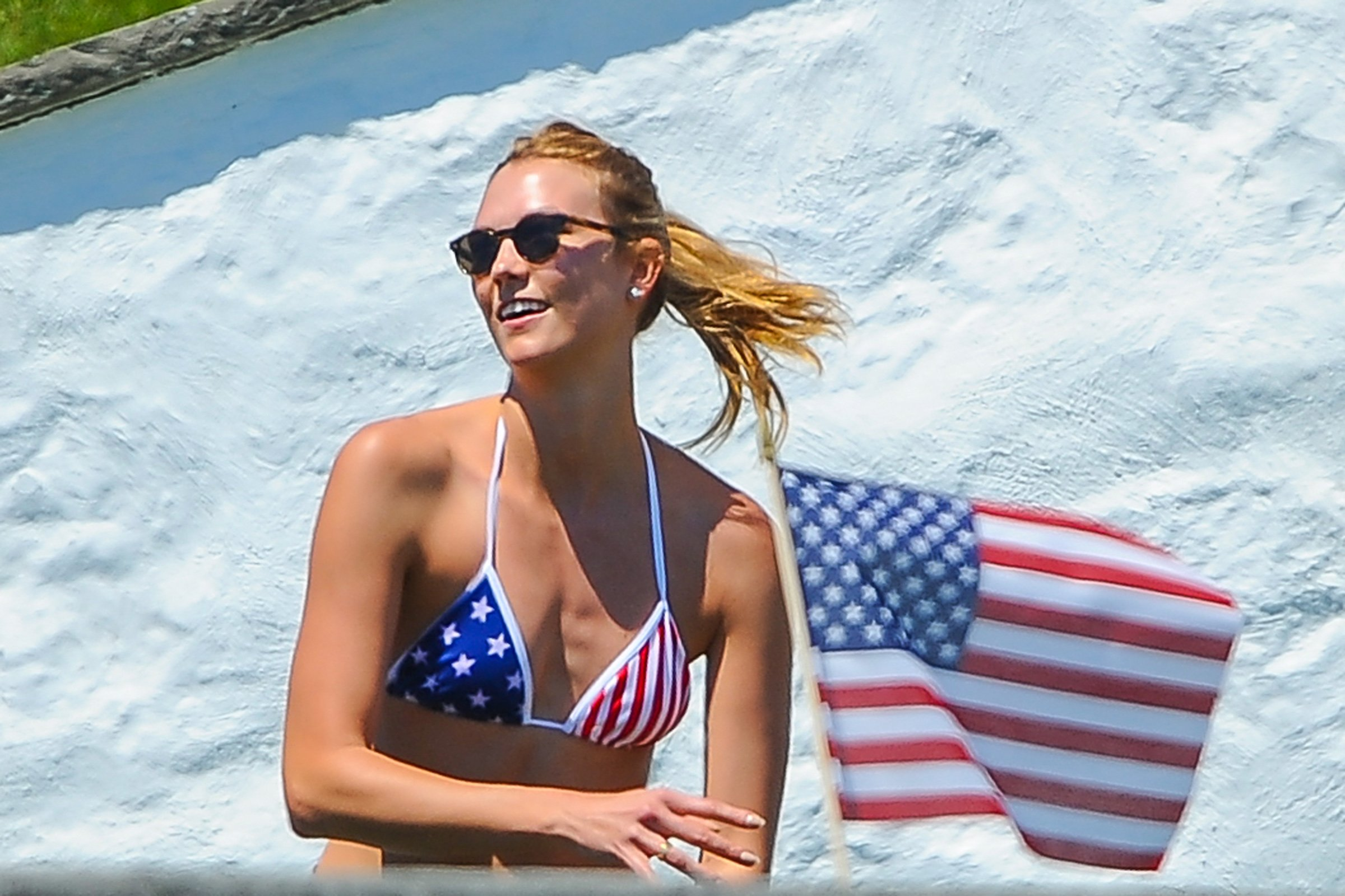 04.July.2016 ñ Westerly - USA *** STRICTLY AVAILABLE FOR UK AND GERMANY USE ONLY *** Westerly, RI - Gigi Hadid and Karlie Kloss play football by the pool at Taylor Swift's house while security make their best efforts to distract the shutterbugs. Gigi is wearing a red, white, and blue striped one piece while Karlie Kloss bares more skin in an American Flag bikini. BYLINE MUST READ : AKM-GSI-XPOSURE ***UK CLIENTS - PICTURES CONTAINING CHILDREN PLEASE PIXELATE FACE PRIOR TO PUBLICATION *** *UK CLIENTS MUST CALL PRIOR TO TV OR ONLINE USAGE PLEASE TELEPHONE 0208 344 2007*