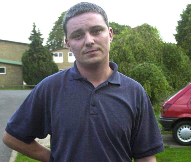 Caretaker Ian Huntley posing outside his home in the village of Soham some 160 km (100 miles) north of London. Huntley was charged with the murder of two schoolgirls -Holly Wells and Jessica Chapman in August 2002. .