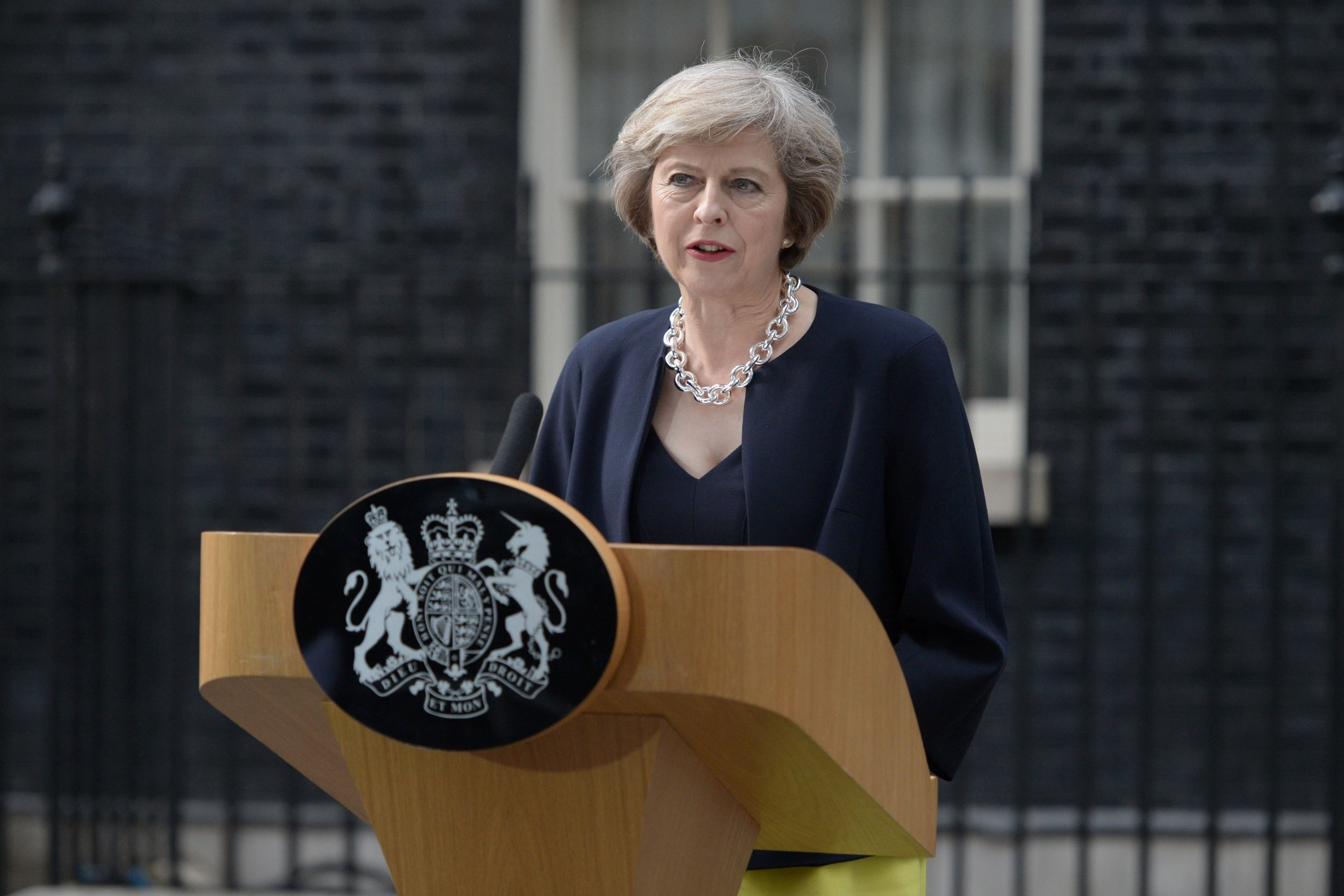 Britain's new Prime Minister Theresa May speaks outside 10 Downing Street in central London on July 13, 2016 on the day she takes office following the formal resignation of David Cameron. Theresa May took office as Britain's second female prime minister on July 13 charged with guiding the UK out of the European Union after a deeply devisive referendum campaign ended with Britain voting to leave and David Cameron resigning. / AFP PHOTO / OLI SCARFFOLI SCARFF/AFP/Getty Images