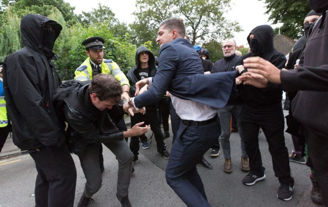 Mandatory Credit: Photo by Vickie Flores/LNP/REX/Shutterstock (5770918j)nScuffles and a fight breaks out between a Boris supporter, Class War and police. Demonstrators from Class War stage a protest outside Foreign Secretary, Boris Johnson's house in north London against Boris Johnson's appointment as Foreign secretary, claiming he is racist. Scuffles broke out between a passer by who supported Boris Johnson, protesters and police.nClass War protest outside Boris Johnson's house, London, UK - 15 Jul 2016nn