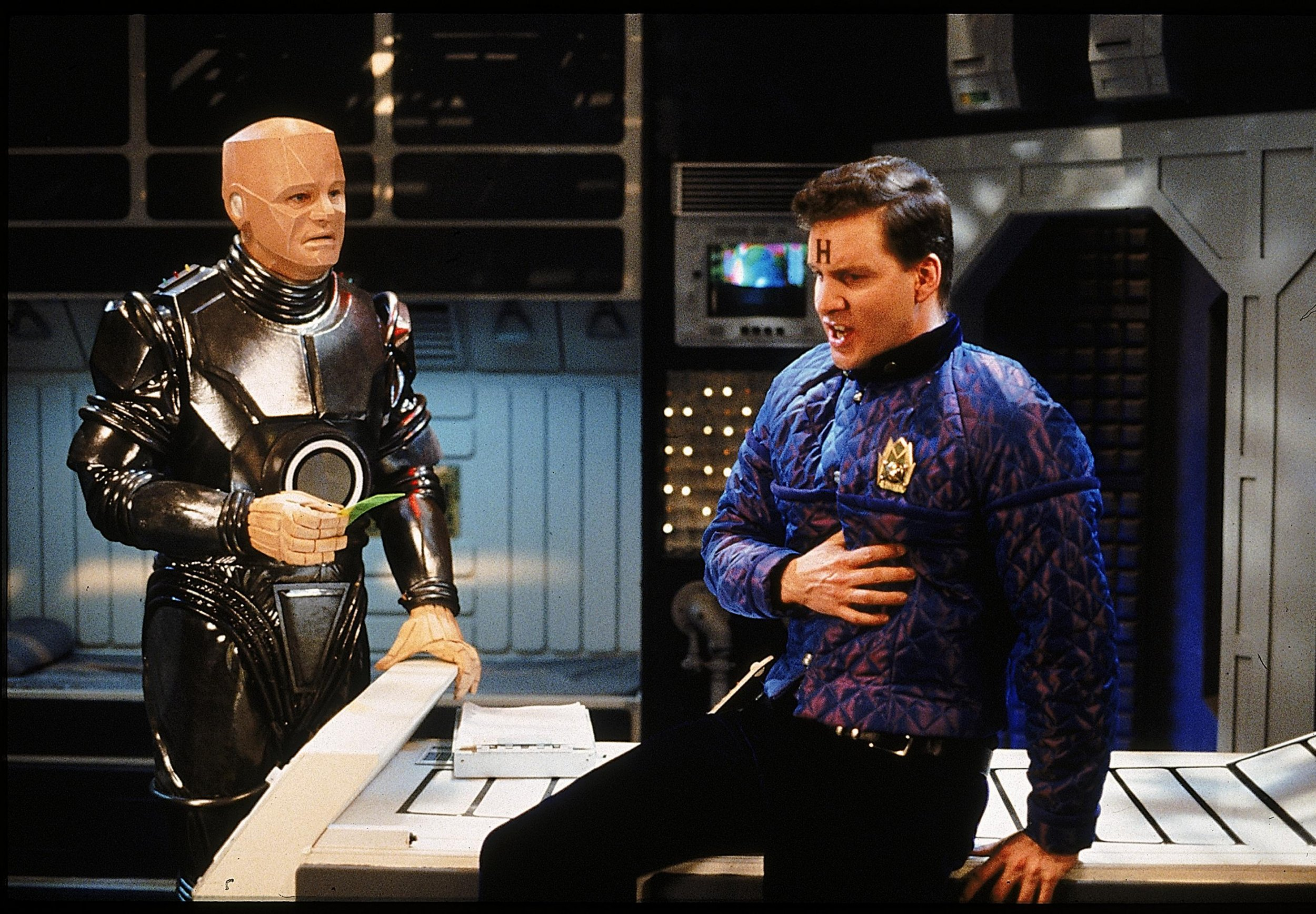 A scene from the television programme Red Dwarf, starring Robert Llewellyn as Kryton and Chris Barrie as Arnold Rimmer.