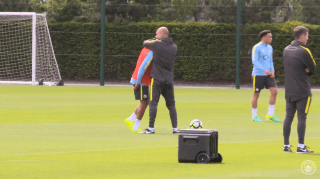 Guardiola took charge of his first training session as manager of Man City on Tuesday (Picture: Man City/YouTube)