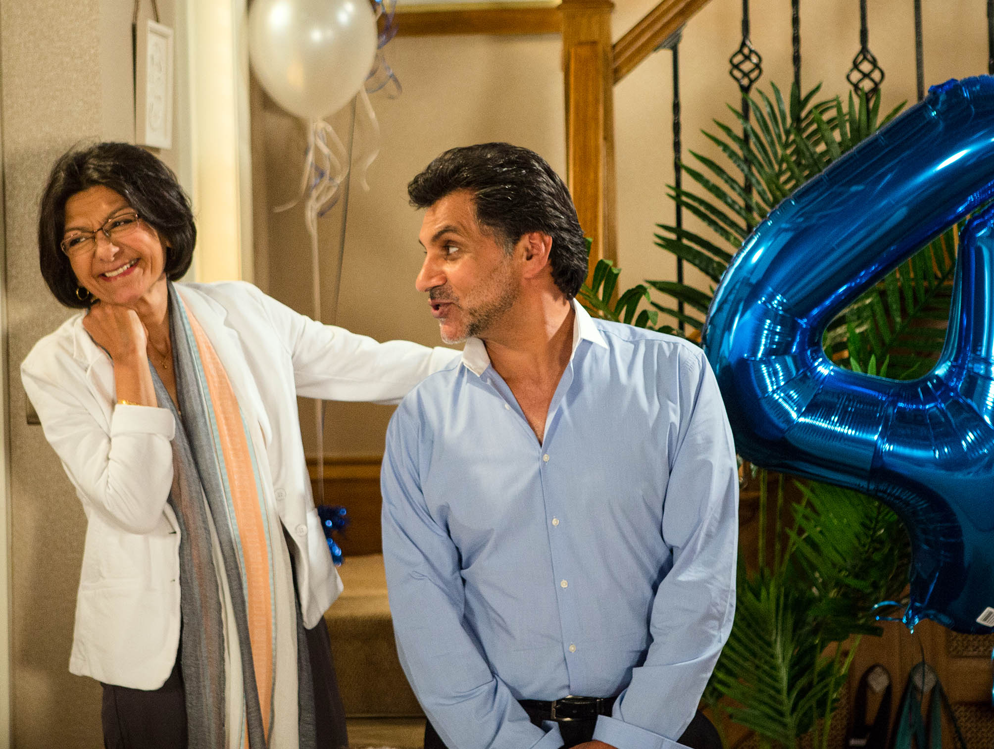 FROM ITV STRICT EMBARGO - NO USE BEFORE TUESDAY 16 AUGUST 2016 Coronation Street - Ep 8973 Monday 22 August 2016 - 1st Ep Sharif Nazir [MARC ANWAR] and Yasmeen Nazir [SHELLEY KING] arrive home and are utterly thrilled to find their grandchildren have arranged a surprise 45th wedding anniversary party. Sharif makes a speech and announces to Yasmeen he's booked a holiday, the honeymoon they never had. However he's interrupted by the arrival of their old friend Sonia Rahman [SUDHA BHUCHAR], who clearly upset, explains her husband has thrown her out. While a concerned Yasmeen heads off to make Sonia a cup of tea, grim-faced Sharif makes it clear he's unimpressed by her surprise visit. Picture contact: david.crook@itv.com on 0161 952 6214 Photographer: Mark Bruce This photograph is (C) ITV Plc and can only be reproduced for editorial purposes directly in connection with the programme or event mentioned above, or ITV plc. Once made available by ITV plc Picture Desk, this photograph can be reproduced once only up until the transmission [TX] date and no reproduction fee will be charged. Any subsequent usage may incur a fee. This photograph must not be manipulated [excluding basic cropping] in a manner which alters the visual appearance of the person photographed deemed detrimental or inappropriate by ITV plc Picture Desk. This photograph must not be syndicated to any other company, publication or website, or permanently archived, without the express written permission of ITV Plc Picture Desk. Full Terms and conditions are available on the website www.itvpictures.com