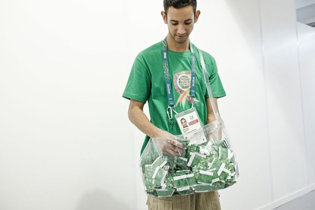 A staff member carries condoms to refill delivering machine at the Polyclinic of the Olympic and Paralympic Village for the 2016 Rio Olympic Games in Rio de Janeiro, Brazil, on July 23, 2016. / AFP / YASUYOSHI CHIBA (Photo credit should read YASUYOSHI CHIBA/AFP/Getty Images)