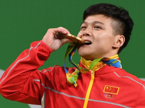 Long Qingquan became the Olympic 65kg weightlifting champion with a world record lift in Rio