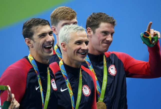 RIO DE JANEIRO, BRAZIL - AUGUST 9: Michael Phelps, Ryan Lochte, Conor Dwyer, Francis Haas (hidden) of Team USA celebrate winning the gold medal during the medal ceremony of the men's 200m freestyle relay on day 4 of the Rio 2016 Olympic Games at Olympic Aquatics Stadium on August 9, 2016 in Rio de Janeiro, Brazil. (Photo by Jean Catuffe/Getty Images)