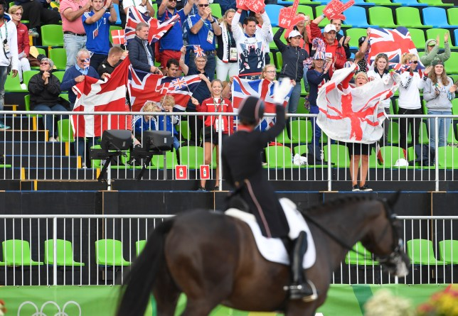 Britain's Charlotte Dujardin on Valegro waves to wellwishers after performing in the Equestrian's Dressage Grand Prix team final event of the Rio 2016 Olympic Games at the Olympic Equestrian Centre in Rio de Janeiro, Brazil, on August 12, 2016. / AFP / John MACDOUGALL        (Photo credit should read JOHN MACDOUGALL/AFP/Getty Images)