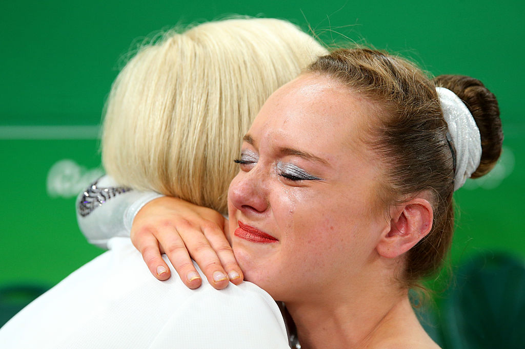 RIO DE JANEIRO, BRAZIL - AUGUST 16: Amy Tinkler of Great Britain celebrates winning the bronze medal with her coach after competing on the Women's Floor final on Day 11 of the Rio 2016 Olympic Games at the Rio Olympic Arena on August 16, 2016 in Rio de Janeiro, Brazil. (Photo by Alex Livesey/Getty Images)