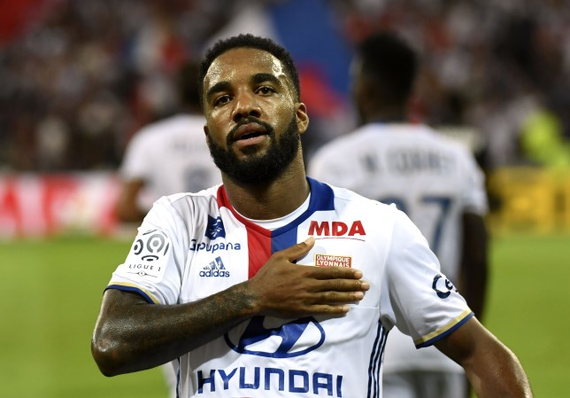 Lyon's French forward Alexandre Lacazette celebrates after scoring a goal during the French Ligue 1 football match Olympique Lyonnais (OL) against Caen (SMC) on August 19, 2016, at the Parc Olympique Lyonnais stadium in Decines-Charpieu near Lyon, southeastern France. / AFP / PHILIPPE DESMAZES (Photo credit should read PHILIPPE DESMAZES/AFP/Getty Images)