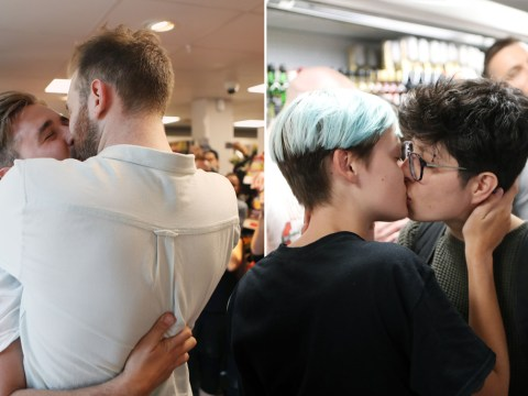 Hundreds stage Sainsbury's 'kiss-in' after gay couple 'kicked out for holding hands'