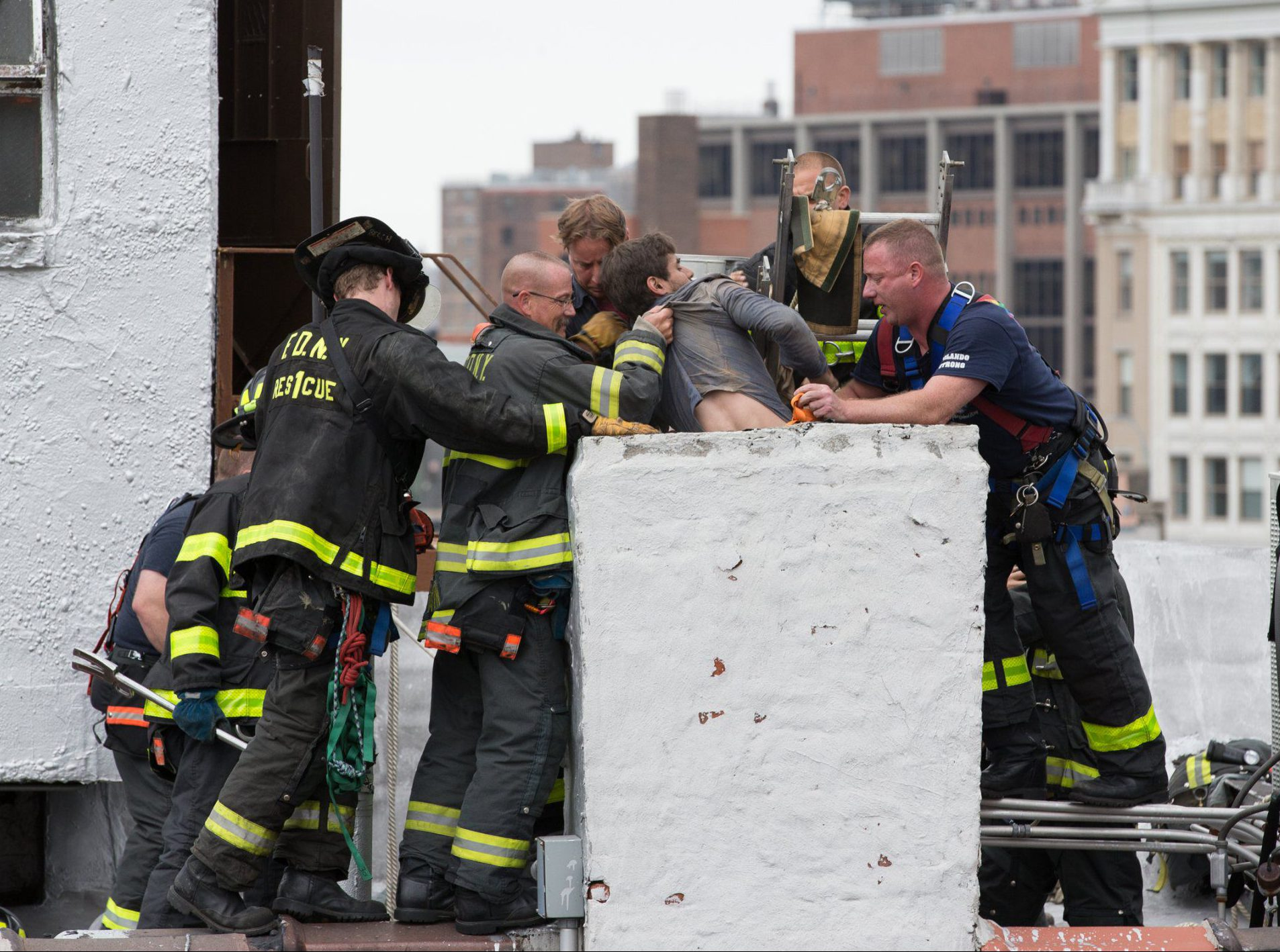 Guy goes for a cigarette on the roof, gets locked out, goes down chimney, it goes wrong