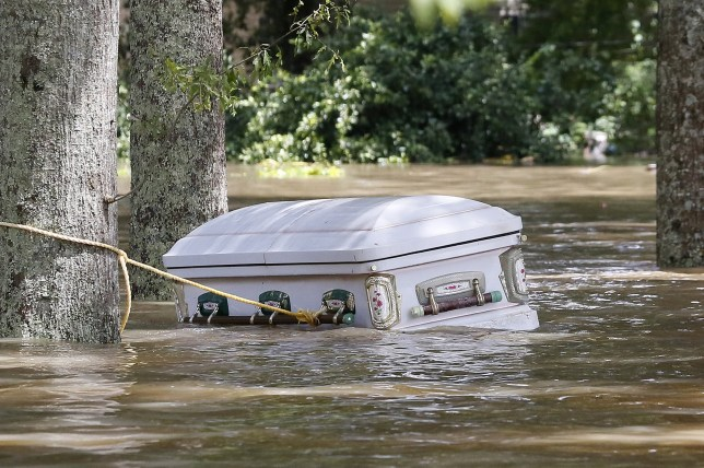 A casket is seen floating in flood waters in Ascension Parish, Louisiana, U.S., August 15, 2016. REUTERS/Jonathan Bachman