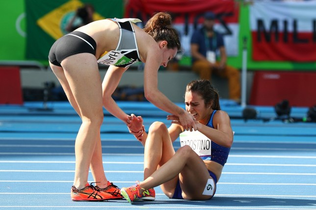 RIO DE JANEIRO, BRAZIL - AUGUST 16: Abbey D'Agostino of the United States (R) is assisted by Nikki Hamblin of New Zealand after a collision during the Women's 5000m Round 1 - Heat 2 on Day 11 of the Rio 2016 Olympic Games at the Olympic Stadium on August 16, 2016 in Rio de Janeiro, Brazil. (Photo by Ian Walton/Getty Images) *** BESTPIX ***