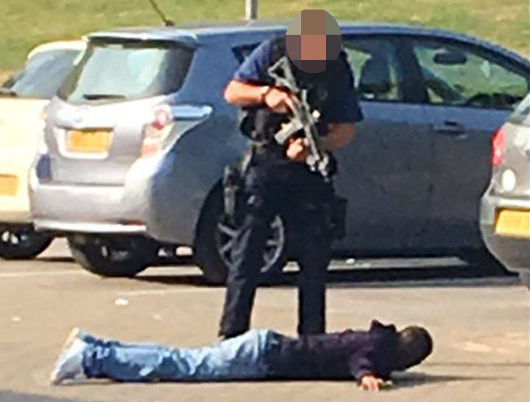 Photo courtesy of Can Ozkutan from his Twitter feed @CanOzkutan of an armed police officer detaining a man near Burdett Road in Mile End after scores of armed police were deployed to east London after men in a car were reported to be carrying a gun. PRESS ASSOCIATION Photo. Issue date: Tuesday August 16, 2016. See PA story POLICE MileEnd. Photo credit should read: Can Ozkutan/PA WirenNOTE TO EDITORS: This handout photo may only be used in for editorial reporting purposes for the contemporaneous illustration of events, things or the people in the image or facts mentioned in the caption. Reuse of the picture may require further permission from the copyright holder.