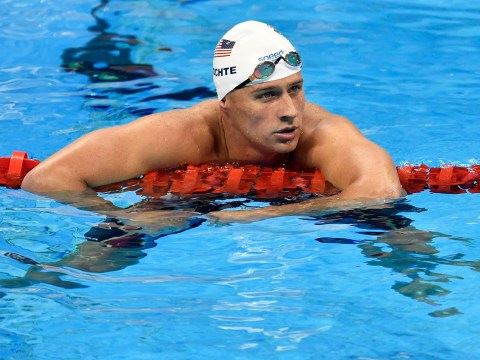 Ryan Lochte says sorry after Rio 'gunpoint robbery' claim