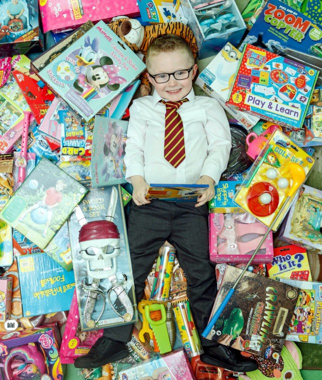 Nathan Hill donated presents to needy children (Picture: SWNS)