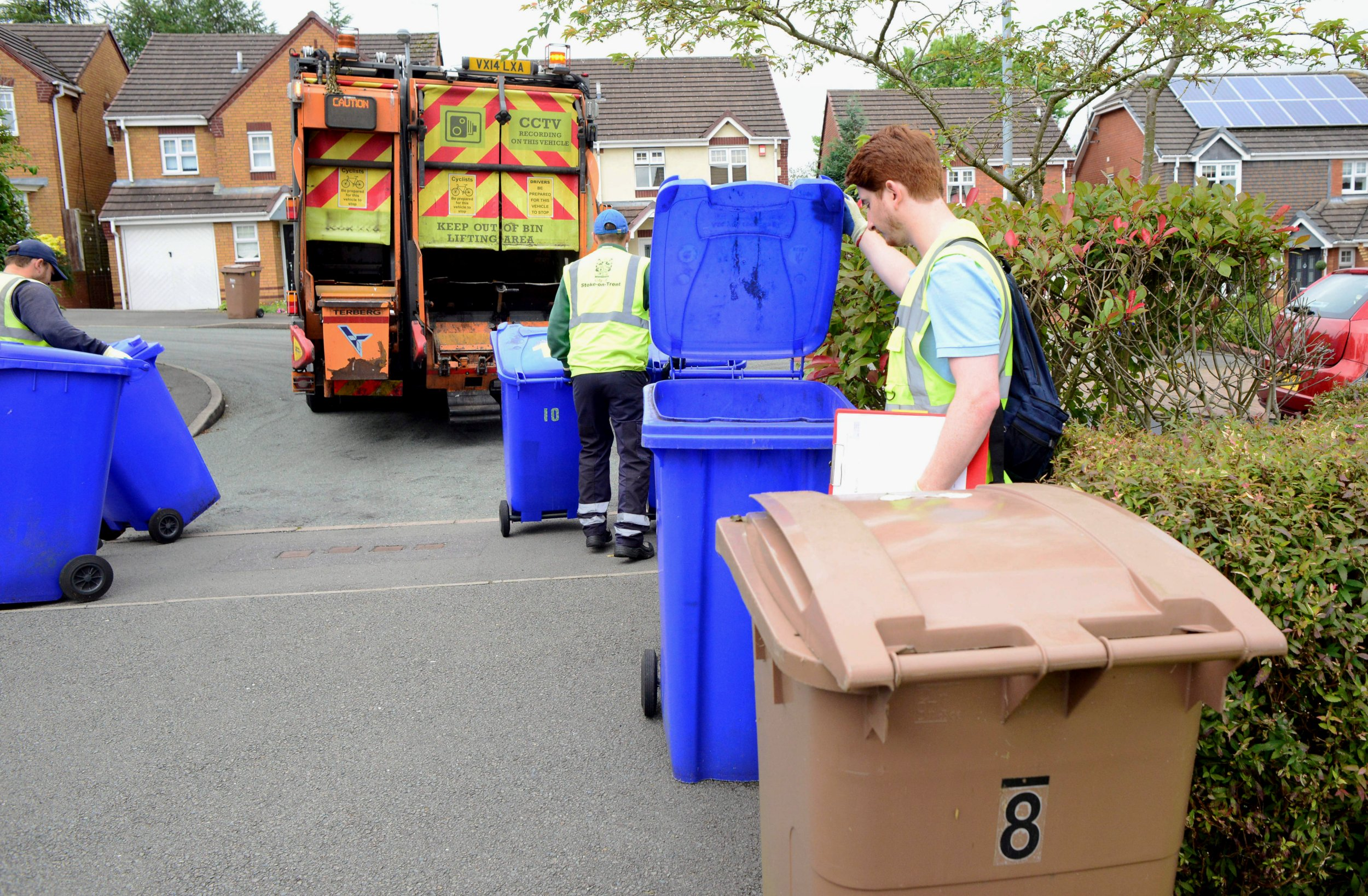 "Waste minimisation office Matthew Lowe checks bins in Stoke-on-Trent, Staffordshire. See News Team story NTIBINS; A council has been blasted for spending £100,000 of taxpayers' cash setting up a 'bin police' team to snoop on residents' RUBBISH. Stoke-on-Trent City Council has taken on the ""waste minimisation"" staff to sift through the contents of blue wheelie bins in a bid to boost its recycling rates. The authority says the six-strong 'bin police' team comes after some families have dumped soiled nappies, sanitary products and other similar items in their recycling. Every household in the area will now be issued with a guide on what they can place in their grey, brown and blue containers. Anyone caught breaching the rules will find a yellow 'warning notice' on their bin meaning their waste may not be collected. Yesterday (Wed), residents blasted the new 'bin police' as ""over the top"" and an ""invasion of privacy""."