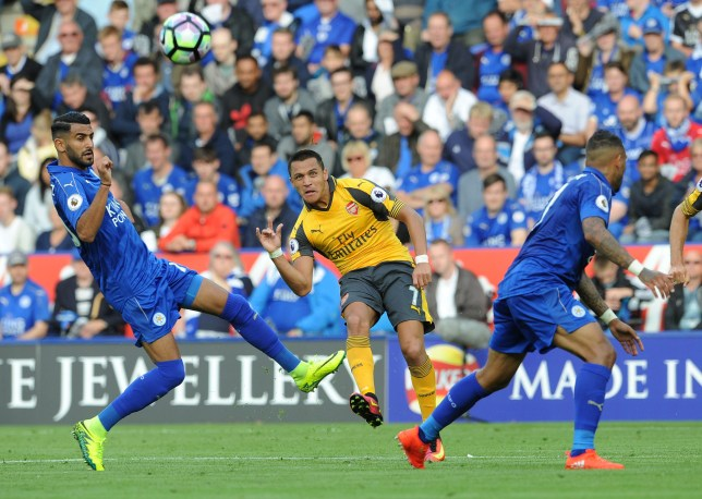 LEICESTER, ENGLAND - AUGUST 20: Alexis Sanchez of Arsenal shoots under pressure from Riyad Mahrez of Leicester during the Premier League match between Leicester City and Arsenal at The King Power Stadium on August 20, 2016 in Leicester, England. (Photo by David Price/Arsenal FC via Getty Images)