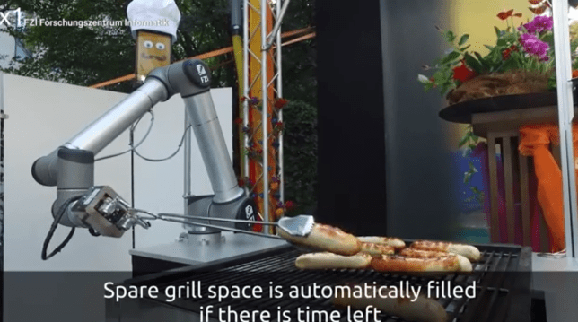 Robot that barbecues sausages (Picture: YouTube)