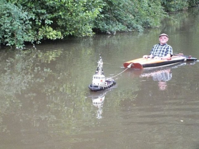 Man gets pulled along canal by his model tug boat