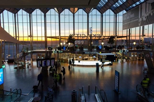 ENF6T8 Sky city at Stockholm Arlanda International Airport during sunset.