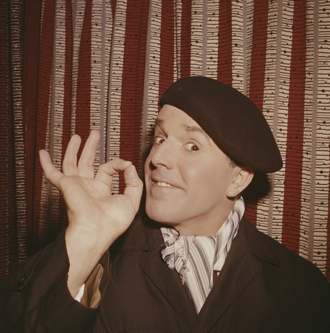 English actor Brian Rix pictured wearing a beret, scarf and mac in 1962. (Photo by Popperfoto/Getty Images)