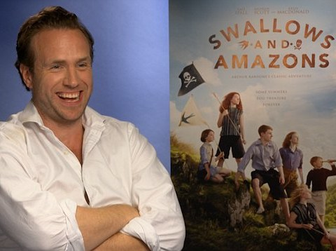 Rafe Spall is sorry if people are 'offended' by the changes in the film version of Swallows And Amazons