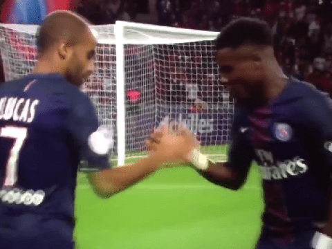 PSG's Lucas Moura and Serge Aurier celebrate goal with a game of rock paper scissors