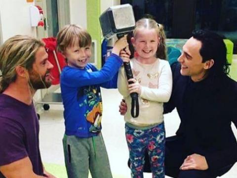 Chris Hemsworth and Tom Hiddleston visit a children's hospital as Thor and Loki