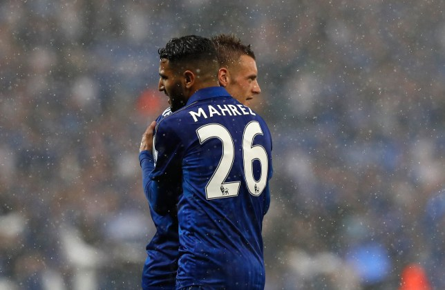 Leicester City's Algerian midfielder Riyad Mahrez (L) embraces Leicester City's English striker Jamie Vardy during the English Premier League football match between Leicester City and Everton at King Power Stadium in Leicester, central England on May 7, 2016. / AFP / ADRIAN DENNIS / RESTRICTED TO EDITORIAL USE. No use with unauthorized audio, video, data, fixture lists, club/league logos or 'live' services. Online in-match use limited to 75 images, no video emulation. No use in betting, games or single club/league/player publications. / (Photo credit should read ADRIAN DENNIS/AFP/Getty Images)