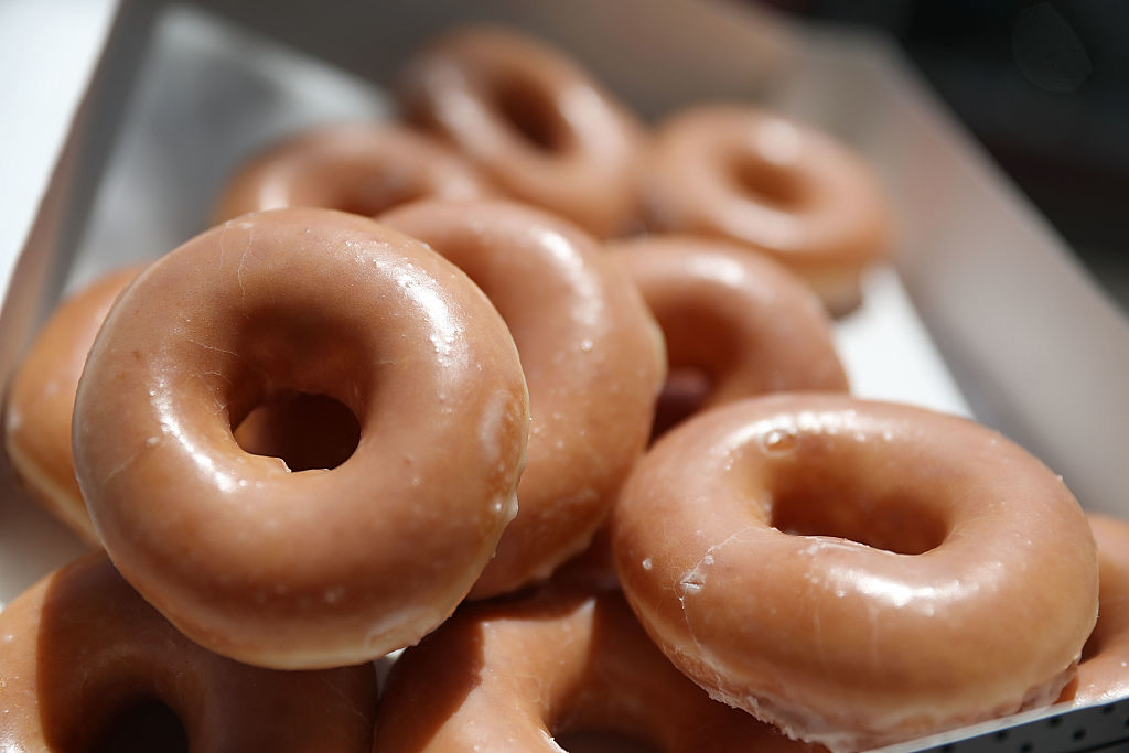 MIAMI, FL - MAY 09: In this photo illustration, Krispy Kreme Donuts are seen on May 09, 2016 in Miami, Florida. JAB Holdings Company, announced it is acquiring Krispy Kreme Donuts in a deal valued at $1.35 billion. (Photo illustration by Joe Raedle/Getty Images)