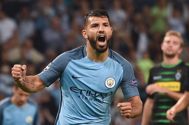 Manchester City's Argentinian striker Sergio Aguero celebrates scoring their second goal from a penalty during the UEFA Champions League group C football match between Manchester City and Borussia Monchengladbach at the Etihad stadium in Manchester, northwest England, on September 14, 2016. / AFP / PAUL ELLIS        (Photo credit should read PAUL ELLIS/AFP/Getty Images)